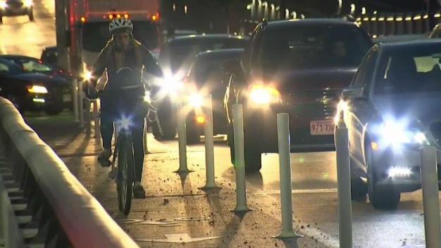 Cyclists Fight to Keep Lane Protectors on Bridge