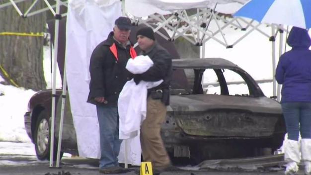 Police Investigate Body in Burning Car at Cemetery
