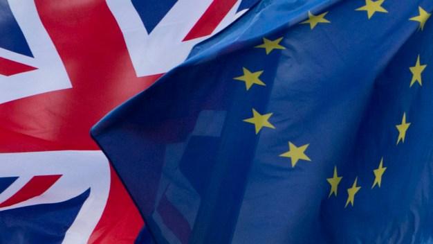 UK's May Postpones Brexit Vote: What This Means