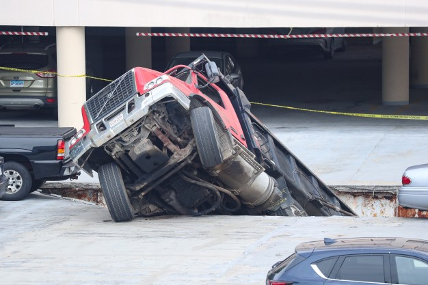 UP CLOSE: Dump Truck Crashes Through Parking Garage Roof