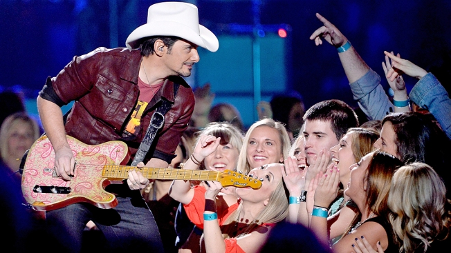 Country singer Brad Paisley performs at high school graduation