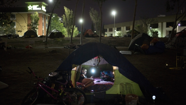Does Giving Food, Showers, Tents Really Help the Homeless?