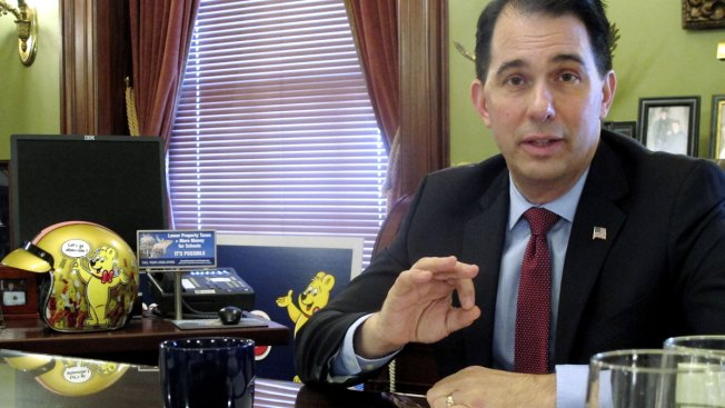 Wisconsin Gov. Scott Walker Signs Sweeping Lame-Duck GOP Bills Weakening Successor, AG