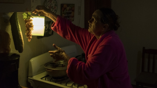 Puerto Ricans Cheer Return of Electricity, But Remain Wary