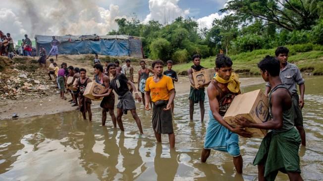 Fleeing Rohingya Muslims Watch as Homes Burn in Myanma