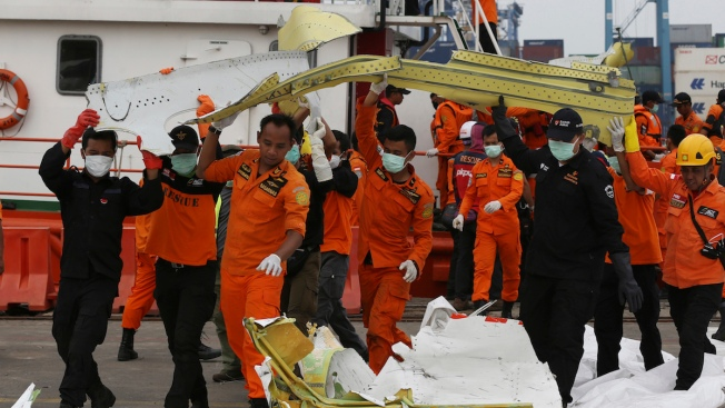 Divers See Indonesian Plane Fuselage, New 'Ping' Heard, Official Says