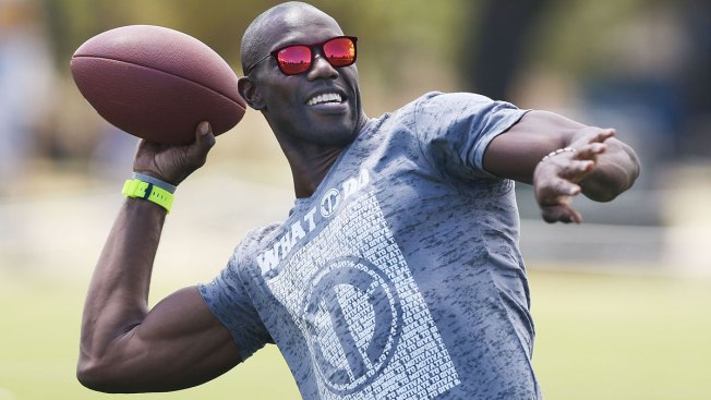 Cheryl Burke partners with National Football League star Terrell Owens