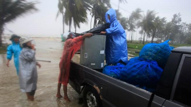 Tropical Storm's Rain, Surging Seas Strike Thai Beaches