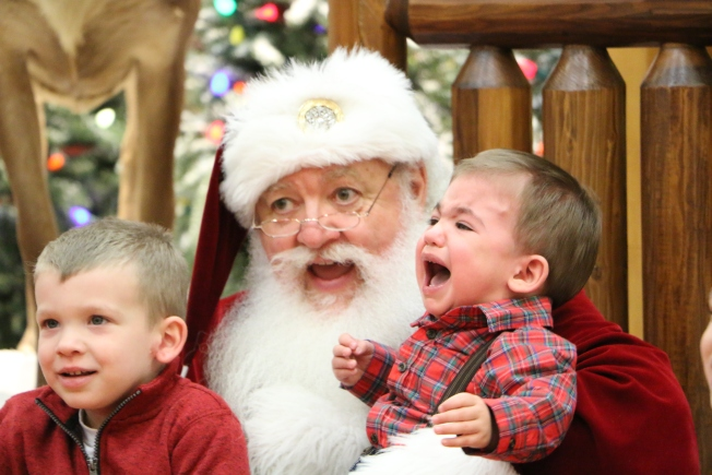 trying to get the perfect photo with santa - Santa Claus With Kids