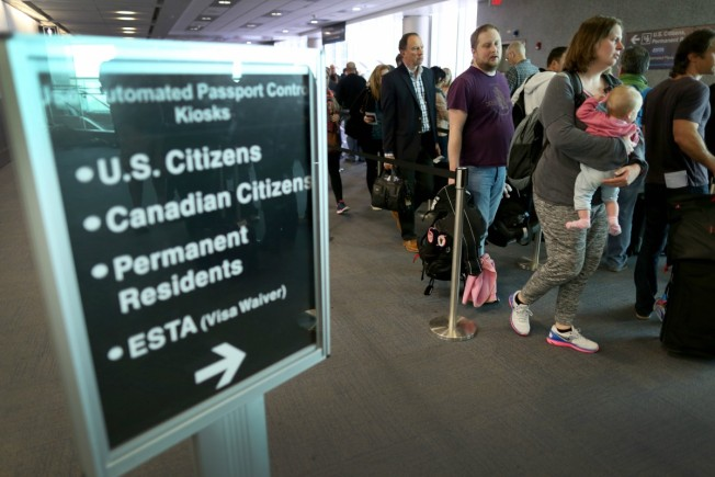 Worldwide travelers briefly face delays entering US