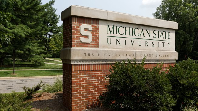 Ex-Michigan State President to Stand Trial; Trustee Quits